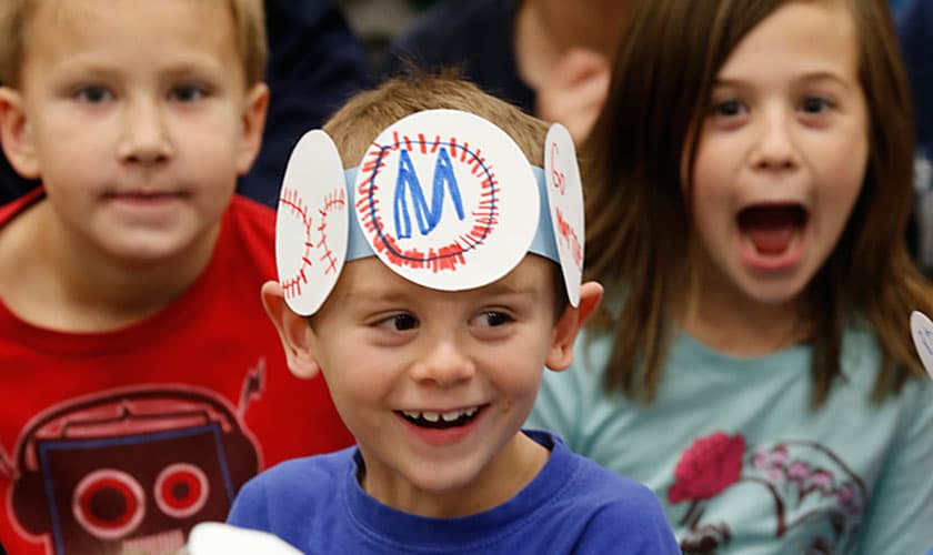 Ellensburg School District Casestudy image of kid in funny hat