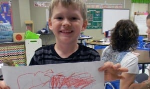 Westplains schools student with drawing
